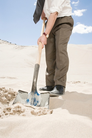 Man digging in desert